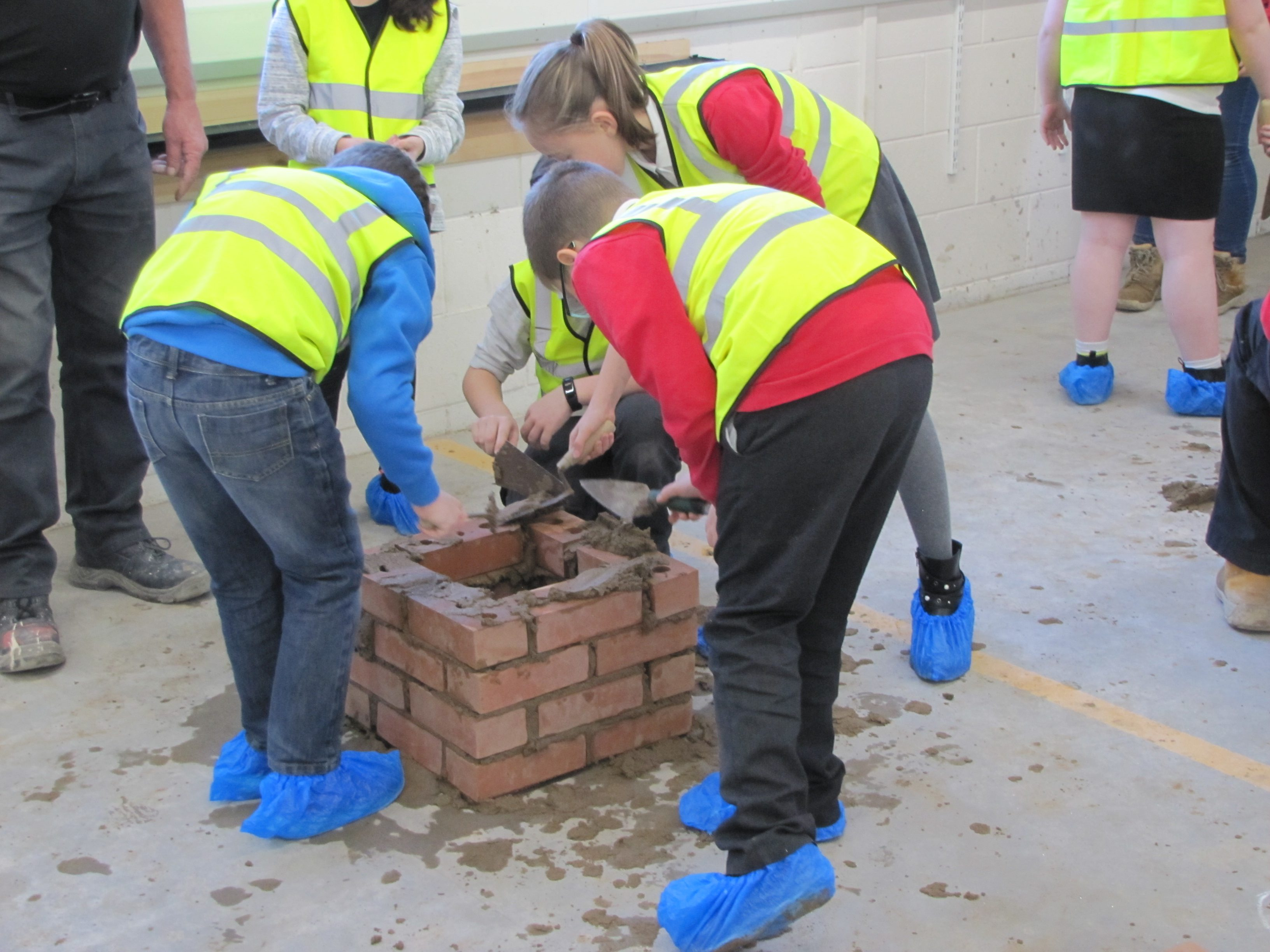 Young people taking part in bricklaying skills